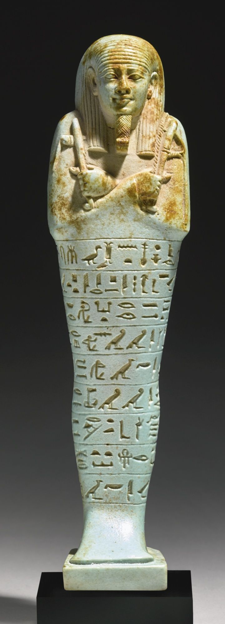 An Egyptian Pale Blue Faience Ushabti of Neferibresaneith, 26th Dynasty, reign of Amasis, 570-526 B.C. | lot | Sotheby's: