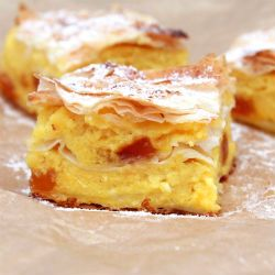 Bougatsa is a greek breakfast pastry consisting of semolina custard, cheese or mince meat in between layers of pyhllo