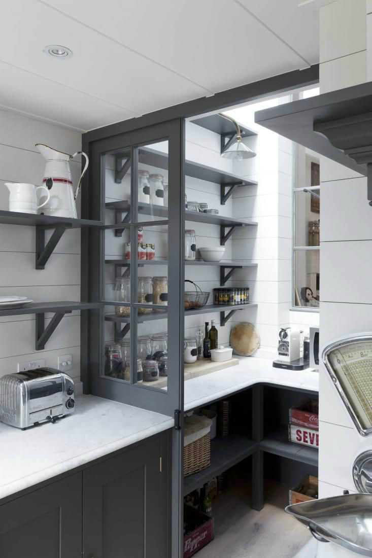 Afunny dead space at the end of this kitchen turned into a pantry witha French bistro feel.Photograph byMatt Clayton A pantry is a great thing to have for kitchen storage,...