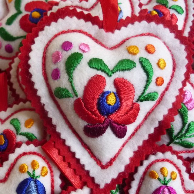 Hand embroidered filled felt heart with hanging tab Red felt backing 11cm long These hearts are embroidered by women from a folk art co- operative i