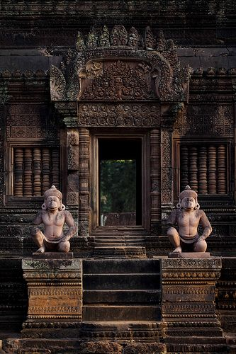 #Doorway Into a Cambodian Surprise,Banteay Srey- Cambodia (by Michael C Hughes) A pair of wonderful Hanuman sculptures guarding the entrance. You will often see Asian people place protective statues at the entryway. Chinese like to use Fu Dogs, one male, one female. The female will usually have a baby under her paw. http://patricialee.me/the-mouth-of-qi-2/