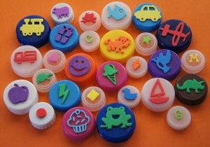 Bottle Cap Stamps.  Made with dollar store foam cutouts.  Great way to repurpose those bottle caps!