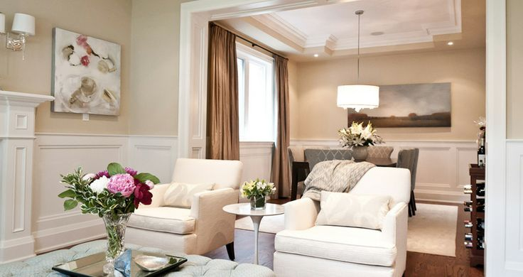 Fia Interiors Room Design with Custom Chairs, Tufted Ottoman and toss cushions.