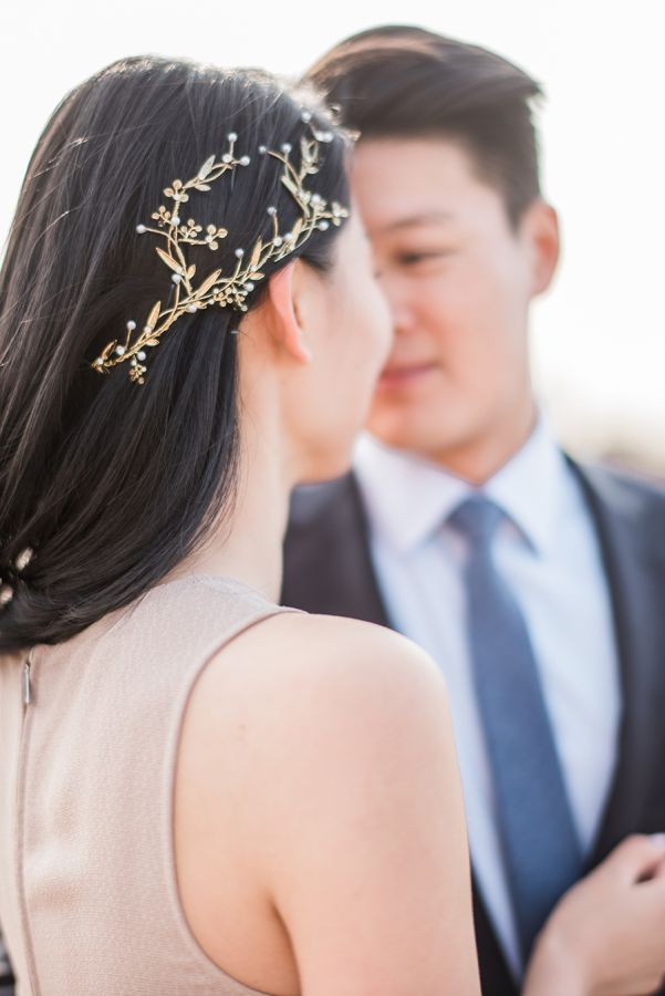 Grecian inspired hair pin by Maggie Wu on SMP: http://www.StyleMePretty.com/2016/07/05/romantic-central-park-pond-row-boat-engagement-session/ | Photography: SallyPinera.com | Hairpiece: MaggieWuStudio.com