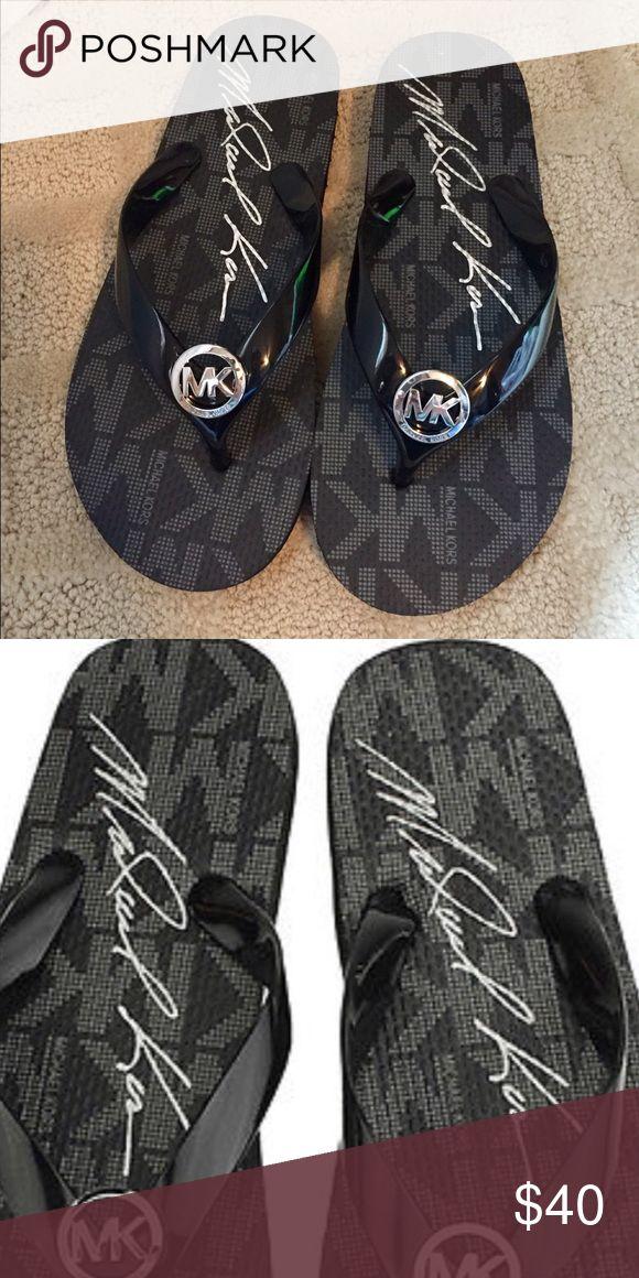 Michael Kors jet set flip flop. NWOT Black flip flop with silver hardware. Never worn! Michael Kors Shoes Sandals