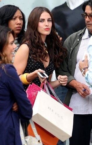 """Jessica Lowndes Photos - Jessica Lowndes has her hands full of shopping bags as she films a scene for """"90210"""" outside Reiss on Robertson Blvd. - Jessica Lowndes on Set"""