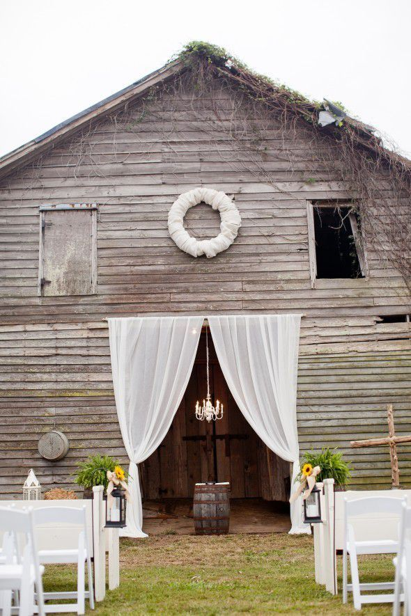 White Drapes For A Barn Wedding