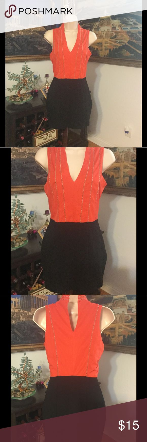 "Black and orange dress Worn a few times in good condition. Black and orange dress with silver sequence, good for any occasion. Length- 32"" , waist- 26"" , shoulder 12.5"" The clothing company Dresses Mini"