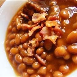 What a great way to wake up pork and beans. Add a little sweet, a little spice, and a little onion, and then bake it with bacon over the top.