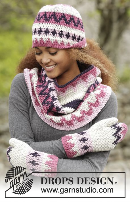 Pink Maze set consisting of hat, cowl and mittens in #tapestrycrochet by DROPS Design. Free pattern online!