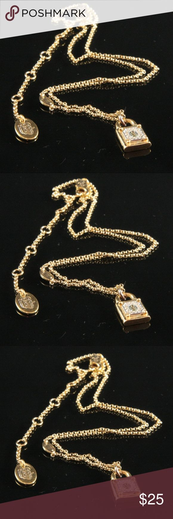 """Juicy Couture Necklace Lock Pendant Gold Tone Juicy Couture Necklace.  Gold tone chain.  Lock pendant inset with tiny brilliant clear rhinestones on front and Juicy Couture insignia on reverse.  Pendant is .6 inches in height, and .4 inches wide.  Chain is 16"""" to 18"""" in length, including 3"""" chain extender.  Classic Juicy Couture clasp and crown charm in chain and at end of chain extender.  Used item: any wear shown in pics. Fair condition, with wear on corners and on the charms. Priced…"""
