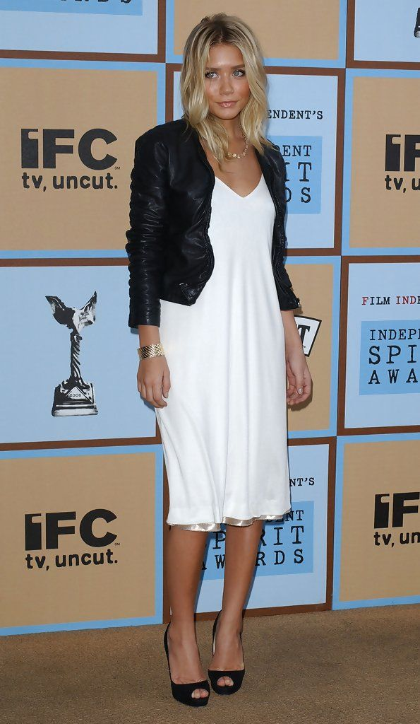 Ashley Olsen. flowing white with black leather