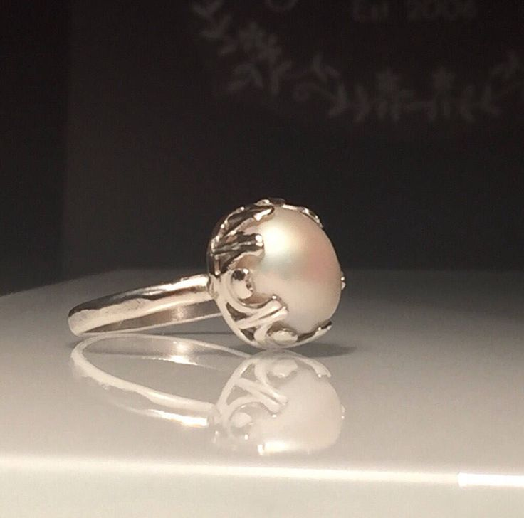 A personal favorite from my Etsy shop https://www.etsy.com/listing/535151136/crown-pearl-ringnatural-white-pearl