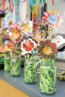 recycled magazine flowers- layered on top of each other.  very cute!