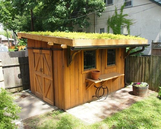 Cool Wood Shed Ideas For Your House: Wood Shed With Green Grass Roof  Sliding Doors