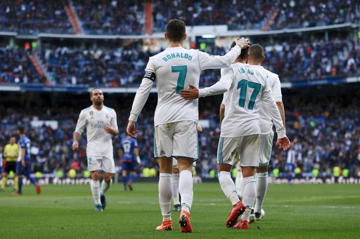 Cristiano Ronaldo Photos - Cristiano Ronaldo (L) of Real Madrid CF celebrates scoring their second goal with teammate Lucas Vazquez (R) during the La Liga match between Real Madrid CF and Deportivo Alaves at Estadio Santiago Bernabeu on February 24, 2018 in Madrid, Spain. - Real Madrid vs. Deportivo Alaves - La Liga