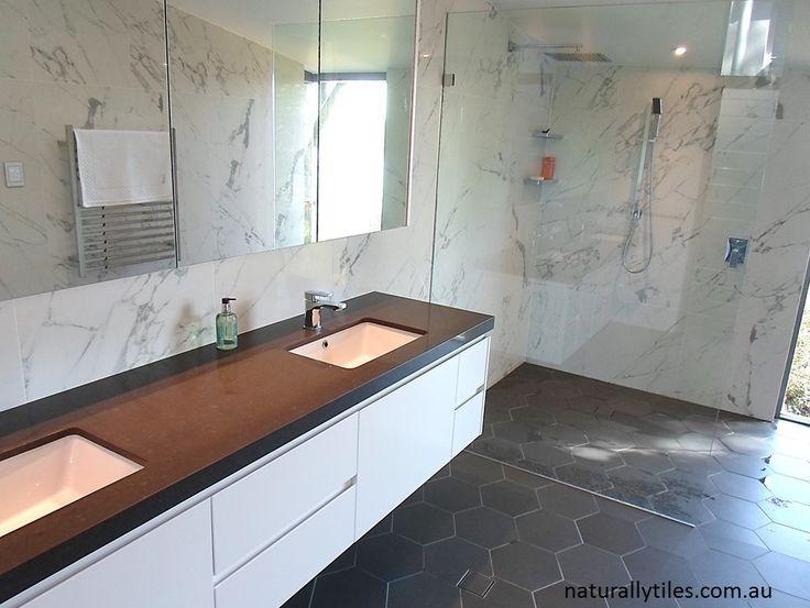 contemporary bathroom venatino carrara walls bluestone hex floor parisi franco tapware