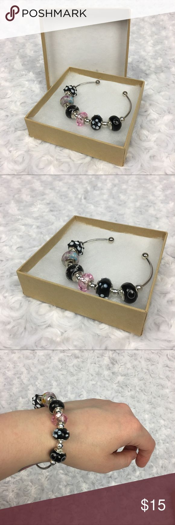 Thin Open Cuff Bracelet with Floral & Black Beads thin open cuff braclet with floral & black beads  This is handmade open cuff braclet, it has 6 larger rounded beads and 7 smaller silver beads separating the larger beads.   The cuff is slightly bendable, so you can adjust to your size!  * See photos for measurements and more details *  Please note: Colors may vary slightly due to different display screen calibration. [AA-15] Handmade Jewelry Bracelets