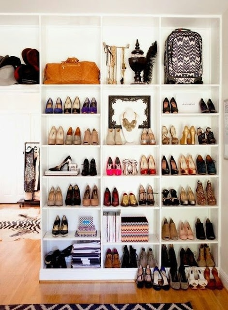 Shoe shelves. I'll be needing something like this for my growing collection of works of art (Melissa shoes). I like how the shelving runs along the whole wall and can house/display other bits and pieces.