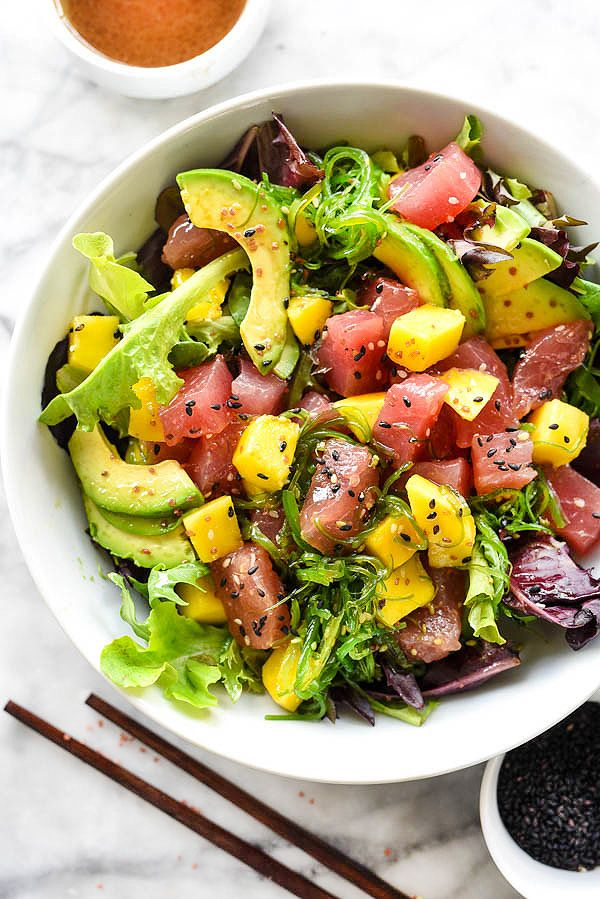 A simple three ingredient dressing tops fresh ahi tuna, mango and avocado on a bed of spring mix in this flavorful Asian salad, perfect for lunch or dinner.