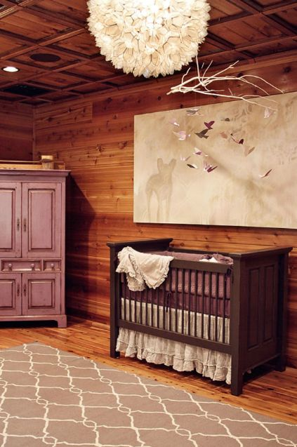 Rustic nursery design with Surya Jill Rosenwald Fallon Rug - Gray, chocolate brown crib, plum crib beding, canvas art, pink & purple mobile, lilac armoire and Viva Terra Lotus Flower Chandelier.