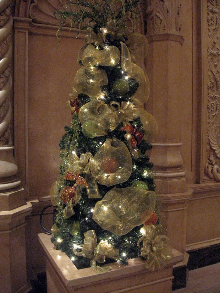 A decorated pedestal chistmas tree would be a great addition on my front porch with outdoor   lights, balls and icicles.