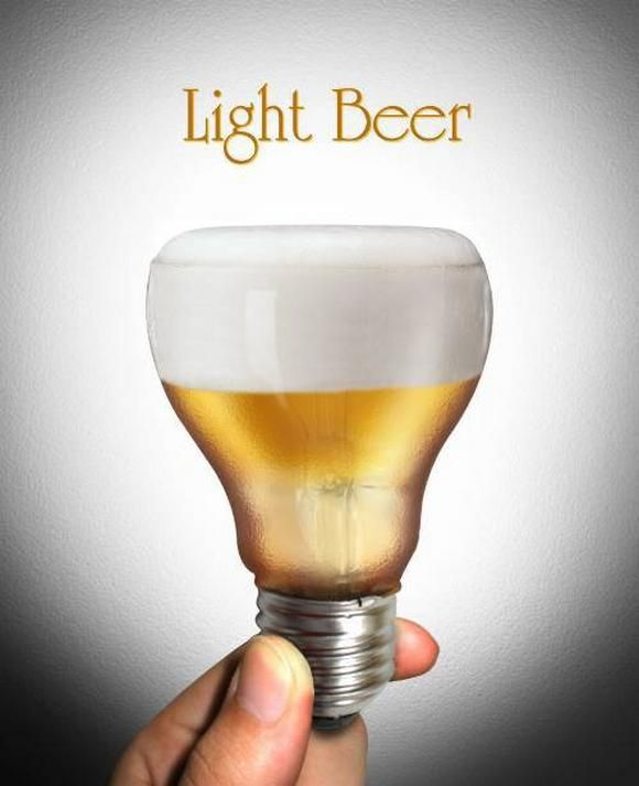 Creative Advertisement | Designer: Propel Marketing. the color in the background is white and black. The texture is show that light beer, light bulb on the bottom and the beer on the top, look like a glass.