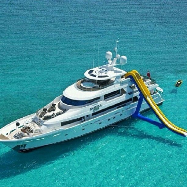 Yacht with a FreeStyle Cruiser inflatable water slide. #Yachts #YachtToys #YachtWaterToys--been there done that !