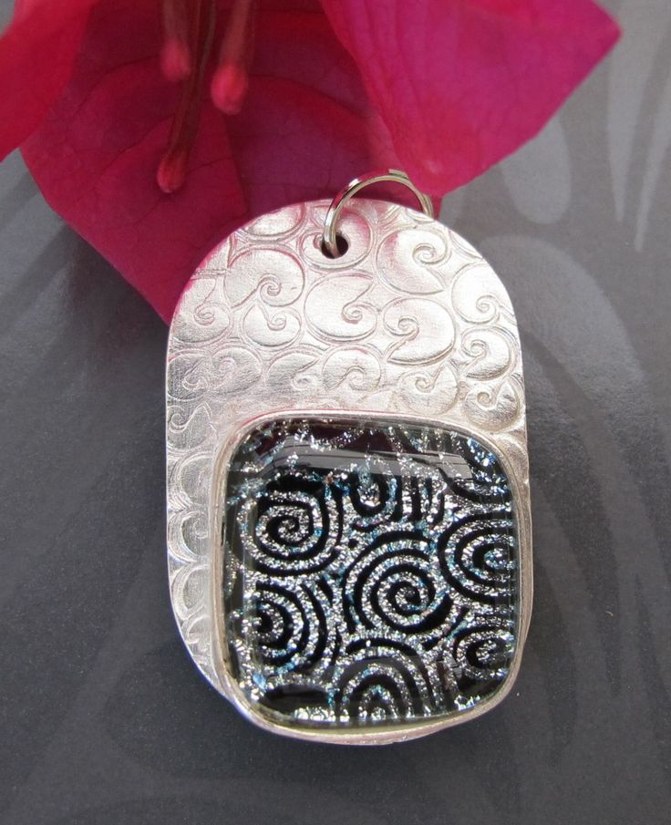 $89.00  3.4 cms long. Swirly black and silver cabochon on swirly silver background.Made by Julie Primmer