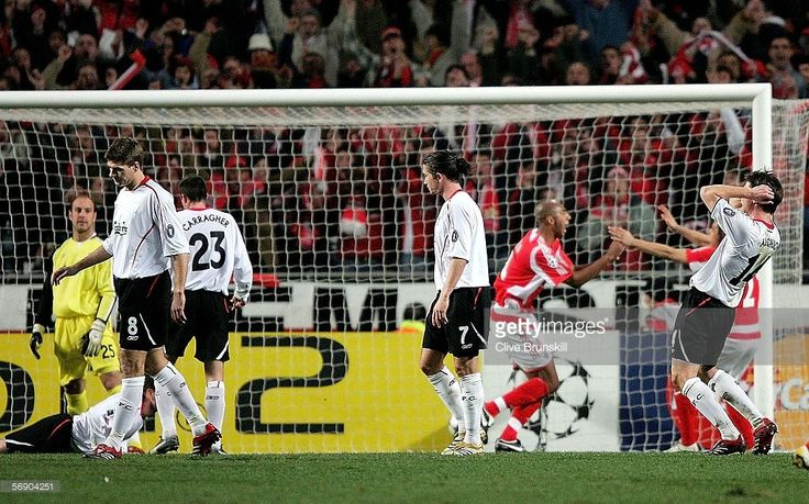Liverpool players (L-R) Steven Gerrard, Harry Kewell and Xabi Alonso show their dejection after Luisao of Benfica scores the winning goal during the UEFA Champions League round of 16, first leg match between Benfica and Liverpool on February 21, 2006