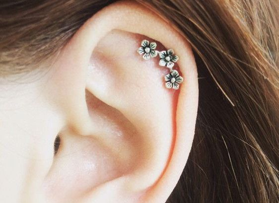 316L Stainless Steel Triple Flower Cartilage Earring Crafted from 316L Stainless Steel, this elegant piece of jewelry features 3 beautiful flowers with Clear CZ perfectly inlaid in the center of each