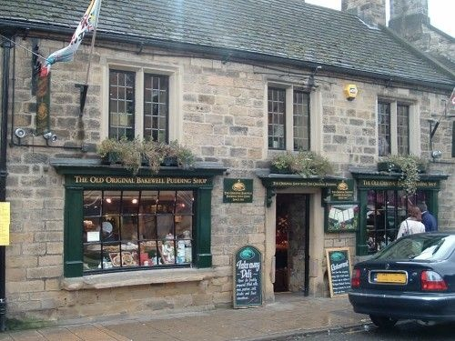 Bakewell ~ No visitor to Bakewell should go away without sampling the original recipe for the Bakewell Tart, although the correct name of the confection is ' Bakewell Pudding'.  In 1860 the story goes, the cook employed by a Mrs. Graves at the Rutland Arms Hotel was instructed to pour a mixture into a pastry case and then add jam, but the cook reversed the procedure, thus creating a new sweet offering.