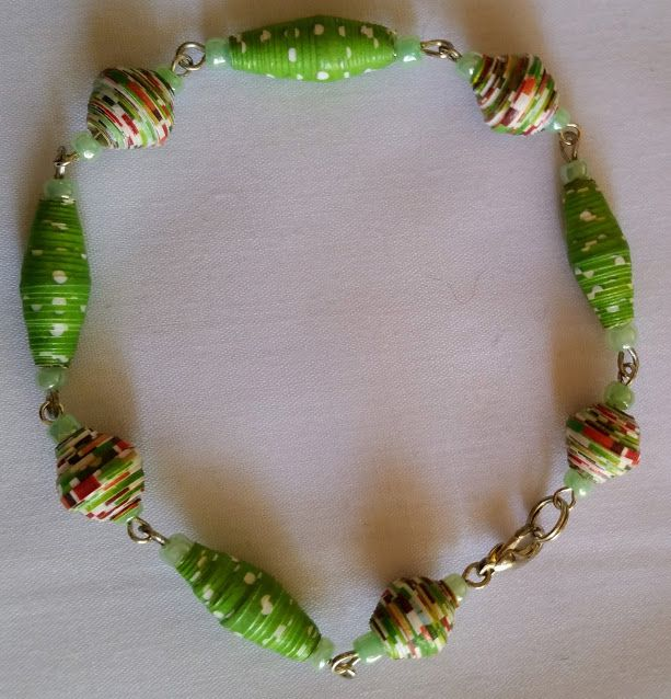 multi coloured and green spotted, paper bead and seed bead, linked bracelet. $15.00
