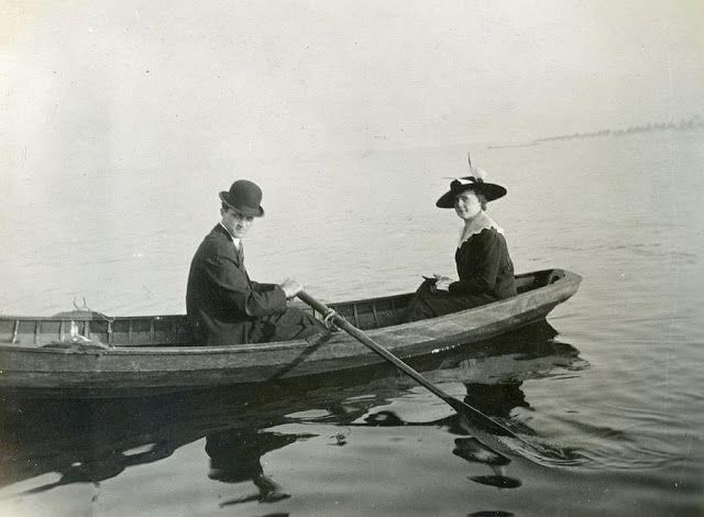 Romantic scene of a couple in a canoe ca. 1905
