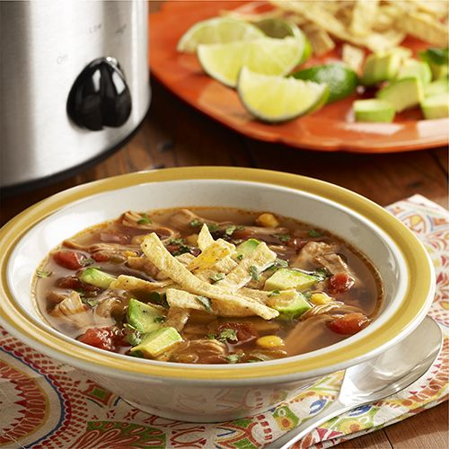 Slow Cooker Chicken Tortilla Soup: A slow cooker chicken tortilla soup recipe with chicken thighs, Southwest mixed vegetables, zesty tomatoes, spices and fresh lime juice