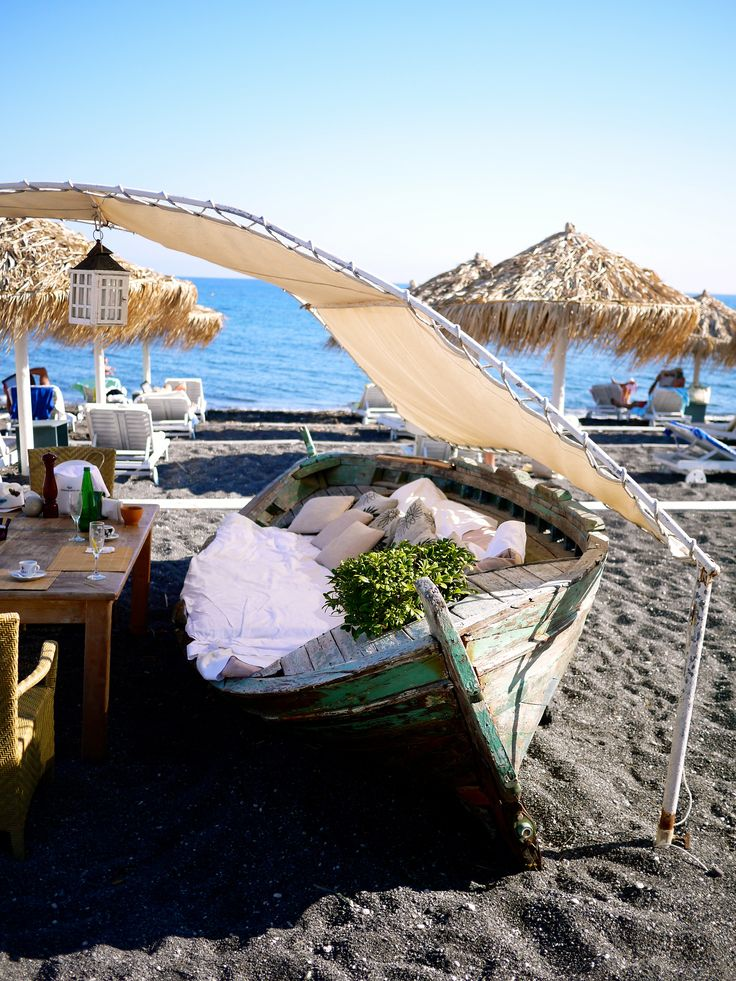 Seaside Restaurant Santorini, Greece Perivolos Beach near Perissa Beachside boat table