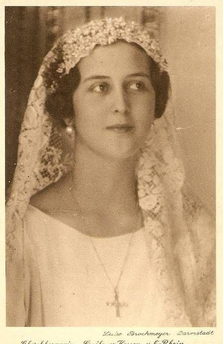 Princess Cecilie of Greece and Denmark as a bride, 1931, in unknown tiara. She was one of the current Duke of Edinburgh's sisters. She married Georg Donatus, Hereditary Grand Duke of Hesse, and had 3 children, but she and her husband and children died in an airplane accident over Belgium en route to London. She was only 26 when she died.