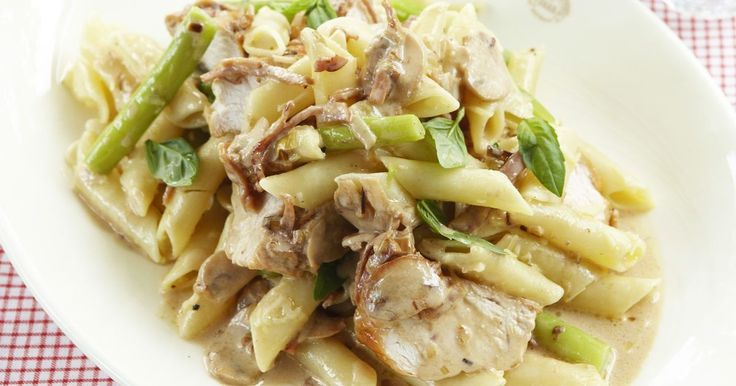 A creamy pasta with chicken, asparagus, shredded parmesan, basil, mushrooms and sliced honey ham.