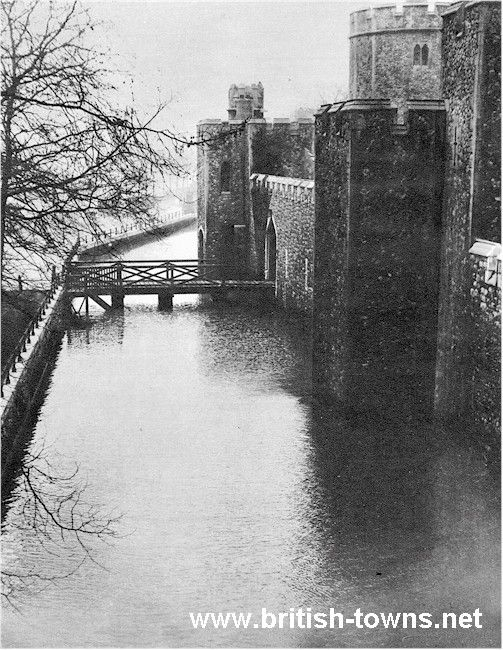 This shows the normally dry moat of the Tower of London during the flooding of the River Thames in 1928. The Embankment at Westminster gave way.