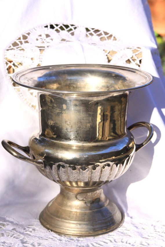 For sale is a large Leonard silver-plate urn, wine cooler, wine chiller, ice bucket, and/or vase. The bottom is signed Leonard EPNS, which is