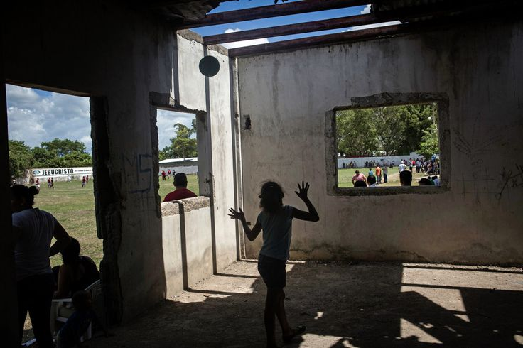 SAN PEDRO SULA, HONDURAS 7/17/2016  Children play in an abandoned structure in the Rivera Hernández neighborhood. Gangs once frequented the building, and the soccer field was used as a place to bury bodies. Katie Orlinsky for The New York Times