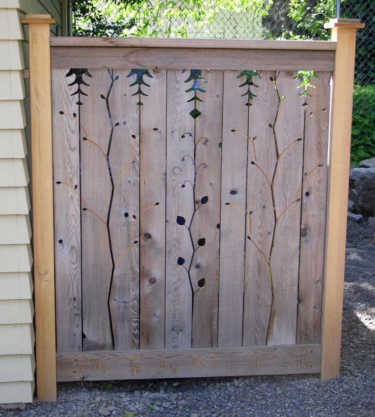 Hide the recycle bins with a decorative panel home decor for Wooden garden fence