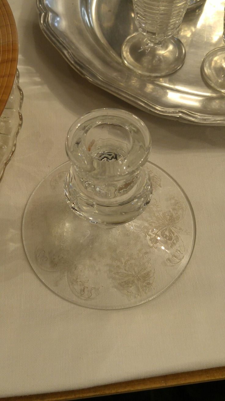 This is a glass candle stick holder. Elizabeth only had one but I have several. Might look cool with a necklace in each one.