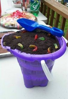 "Oreo Dirt Cake Recipe Ingredients   Kid's Sand Pail & Shovel Set  OR  1 New 8"" Flower Pot  1 1/2-2 lb. Oreo cookies  1 8 oz. tub Cream Cheese  1 cup powdered sugar  1/2 Stick Softened Butter  3 1/2 cups milk  2 small pkg. Instant Vanilla Pudding  12 oz. Cool Whip"