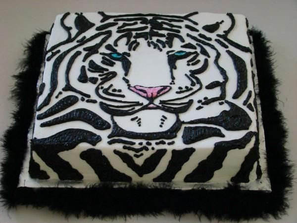 This is a yummy chocolate cake with mint buttercream. The tiger is piped with…