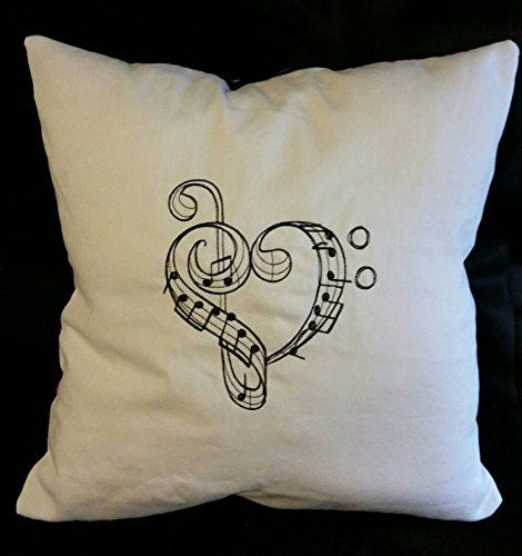 """Valentine's Day Heart shaped music notes handmade embroidered pillow cover. handmade pillow cover with heart shaped music notes machine embroidered design . Back is black cotton with colorful music notes. . this listing is for the pillow cover only. It is made with envelope style back so you can easily slip any 14 or 16 inch square pillow inside it. Easy to change the look of your pillows by just changing the cover and storing it when not in use. Approximate size is 15""""x15"""" I do the..."""