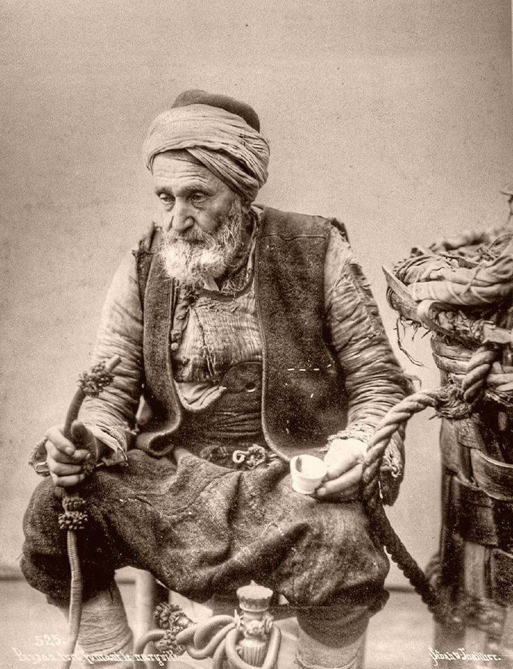 Turkish farmer smoking the water-pipe.