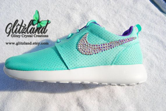 Runs large; order 1/2 size down. These Nike shoes are adorned with Swarovski AB clear crystals. Crystals can be any color to match the color of the
