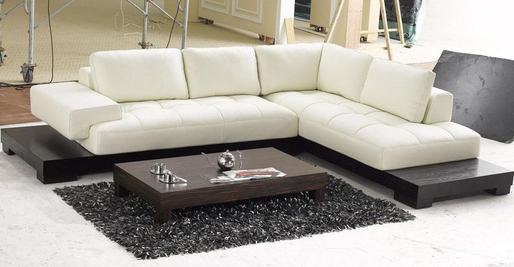 Modern Leather Couch In Living Room Designing  With Dark Wooden Low Coffee Table On The Dark Gray Furry Rug As Well Whiite Tile Floor Wonderful Living Room Designing for Comfortable living Space living room