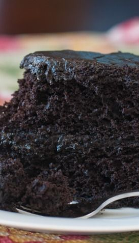 Nanny's Black Midnight Cake Recipe ~ delicious... a dark, chocolate layer cake with a rich dark chocolate frosting.  It's perfectly sweet and super moist and light, and if you are a chocolate lover – this is the cake for you!